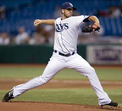 Rays starter James Shields allowed two runs in 6 2/3 innings a day after teammate Matt Garza threw the first no-hitter in franchise history.