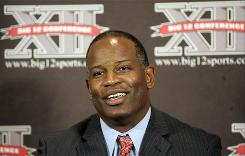 Kansas head football coach Turner Gill talks with reporters at Big 12 Media Day. In his first season at Kansas, Gill will bring an approach that made him successful at Buffalo.