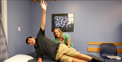 Physical Therapist Kristi Williams of Cincinnati Children's Hospital works with Cole Schlesner, 15, who was hit in the head with a baseball while pitching against a batter using an aluminum bat. Despite up to nine hours a week of outpatient rehabilitation, Schlesner has difficulty walking and lacks full use of his right side.