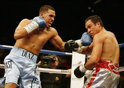 Juan Diaz, left, lost to Juan Manuel Marquez in the fight of the year in February 2009. Diaz now has his sights set on bigger things, starting with a rematch Saturday.
