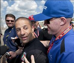 IRL driver Paul Tracy, right, interrupts Tony Kanaan while he speaks to reporters in Edmonton, Alberta, Canada last week.