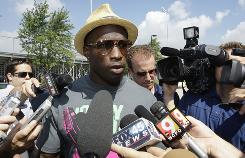 Chad Ochocinco checked into Bengals training camp one day before the expected arrival of Terrell Owens.