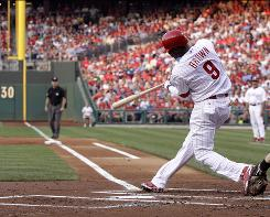 Domonic Brown, 22, laces an RBI double to right in his first major league at bat in the second inning of the Phillies' 7-1 win over the Diamondbacks.