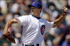 Chicago Cubs starter Ted Lilly delivers a pitch against the Houston Astros on Wednesday in Chicago. With Roy Oswalt and Cliff Lee off the trading-block, Lilly is the best pitching option for teams shopping before Saturday's trade deadline.