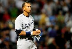 New York Yankees third baseman Alex Rodriguez reacts after striking out during the eighth inning against the Cleveland Indians on Thursday in Cleveland. The Yankees won 11-4. 