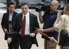 Louisville coach Rick Pitino enters the federal courthouse in Louisville. Pitino faced cross-examination from the defense in Karen Sypher's extortion trial on Thursday.
