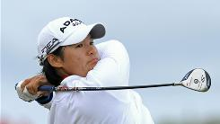 Yani Tseng of Taiwan closely watches her tee shot on No. 3 during the first round of the Women's British Open on Thursday at Royal Birkdale in Southport, England. Tseng eagled the par-5 18th and opened with a 4-under 68.