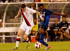 Inter Milan's Nsofor Victor Obinna, right, battling Manchester City's Adam Johnson, scored a goal as the European champs rolled to victory.