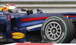 Formula One driver Sebastian Vettel steers his way to the pole position during the qualifying for Sunday's Hungarian Grand Prix in Budapest, Hungary.