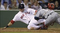 The Red Sox's Ryan Kalish collides with Indians catcher Carlos Santana and is tagged out during the seventh inning. Santana, whose left leg buckled on the play, was carted off the field with his leg in an air cast.