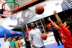 Los Angeles Clippers guard Baron Davis works with children at a 2009 fan event in Mumbai, India. After the NBA's popularity exploded in China, the league is now targeting India to continue to grow its appeal.