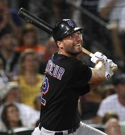 Jeff Francoeur, who was traded by Atlanta to the Mets last year, watches his game-winning solo home run in the ninth inning fall into the right field seats.