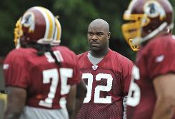 Albert Haynesworth was forced to watch from the sidelines for the first six days of Redskins training camp.