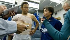 "Kenji Nimura translates for Hiroki Kuroda in the Dodgers clubhouse. Nimura, who was born in Japan but grew up in the U.S., speaks Japanese, Spanish and English. ""If I give a direct translation, it will sound vague,"" Nimura says. ""I cheat a little. ... As long as I get the meaning right."""