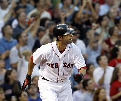 Boston's Mike Lowell, who spent more than a month on the disabled list, homered in his first at-bat Tuesday night.