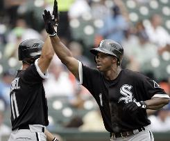 White Sox's Juan Pierre, right, is congratulated by Omar Vizquel after hitting his first home run in almost two years.