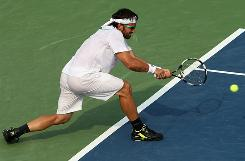 Janko Tipsarevic of Serbia hits a doube-fisted return in his victory against Sam Querrey of the USA at the Legg Mason Tennis Classic on Wednesday in Washington.