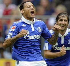 Schalke's Jermaine Jones celebrates his goal against Hamburg during a match last week as teammate Raul looks on. Jones, 28, has been called upon to join the USA squad for the first time.