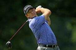 Retief Goosen carded a 4-under 66 that gave him a two-shot lead over Justin Leonard at the Bridgestone Invitational.