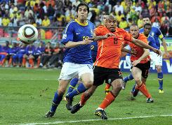 Kaka, battling Netherlands midfielder Nigel de Jong during a World Cup quarterfinal match on July 2, will miss the final match of Real Madrid's two-game tour against the Los Angeles Galaxy.