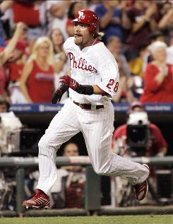 The Phillies' Jayson Werth hits top gear as he heads for home to score the go ahead run off of Carlos Ruiz' single during the eighth inning.