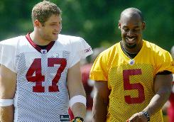 Donovan McNabb, right with Chris Cooley, adds a new dynamic for the Redskins in 2010