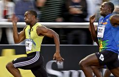Tyson Gay, left, sprints ahead of Usain Bolt to win the men's 100 meters at the DN Galan meet in Stockholm's Olympic Stadium. The loss was Bolt's first in two years.