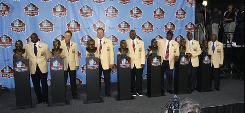 The Pro Football Hall of Fame Class of 2010: from left, running back Emmitt Smith, cornerback and coach Dick LeBeau, offensive lineman Russ Grimm, defensive lineman John Randle, linebacker Rickey Jackson, wide receiver Jerry Rice and running back Floyd Little.