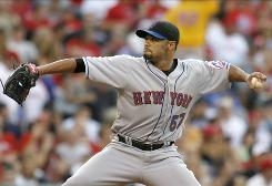 Mets pitcher Johan Santana pitched 7 1/3 shutout innings to lead New York over Philadelphia.