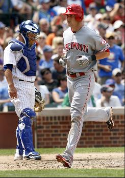 Drew Stubbs crosses home plate after hitting an eighth-inning home run against the Cubs. The rookie snapped a 1-for-37 slump Saturday at Wrigley Field.