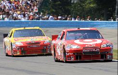 Juan Pablo Montoya, right, leads Marcos Ambrose in Sunday's NASCAR Sprint Cup race at Watkins Glen International. Montoya won and Ambrose was third after winning the Nationwide Series race on Saturday.