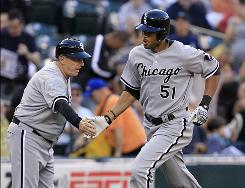 The White Sox claimed Alex Rios, right, and his $60 million contract last August, and it has paid off with a .296 average and 17 homers this season.
