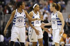 Mystics center Chasity Melvin, left, forward Monique Currie, center and guard Katie Smith helped Washington move three games ahead of the Connecticut Sun for the fourth and final playoff berth in the East.