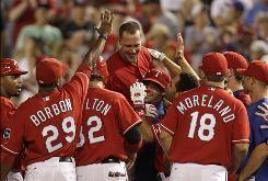 The Rangers' David Murphy, center top, is lifted by teammates after hitting a bases-loaded single off Yankees closer Mariano Rivera in the 10th inning to lift Texas to a 4-3 win.