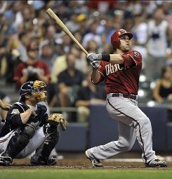 Miguel Montero hits the second of four consecutive home runs by the Diamondbacks against the Brewers in the fourth inning.