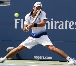 Novak Djokovic of Serbia lines up a backhand during his victory Wednesday against Julien Benneteau of France at the Rogers Cup in Toronto.