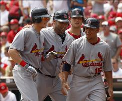Colby Rasmus, far left, is congratulated by teammates (from left to right) Abert Pujols, Matt Holliday and Jon Jay after his grand slam in the fifth inning.