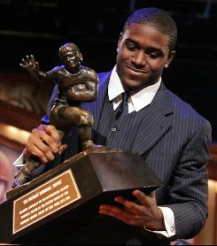 Reggie Bush, seen here receiving the Heisman Trophy in December 2005, was found to have received illicit cash and benefits from a would-be sports marketer while starring for USC.