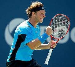 David Nalbandian of Argentina celebrates a point during his victory Thursday against Sweden's Robin Soderling at the Rogers Cup in Toronto.