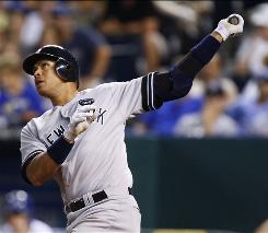Alex Rodriguez hits a two-run homer in the ninth inning, the third of his three home runs in the Yankees' 8-3 win over the Royals.
