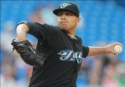 Starter Ricky Romero, 25, who signed a five-year contract with the Blue Jays Saturday, is 9-7 with a 3.53 ERA this season.