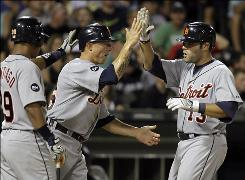 TheTigers' Alex Avila, right, celebrates with Brandon Inge, center, and Ramon Santiago after hitting a two-run homer against the White Sox in the ninth inning.