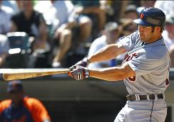 Johnny Damon hits a clutch two-run triple in the eighth inning to help the Tigers rally for a 13-8 win over the White Sox.