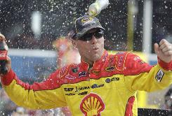 Kevin Harvick celebrates in victory lane at Michigan International Speedway after scoring his third Sprint Cup win of the season.