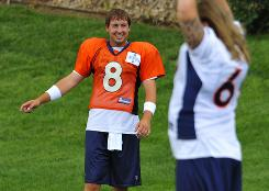 Kyle Orton enters his second season as the Broncos QB with two new competitors for his spot in Denver  Brady Quinn and Tim Tebow.