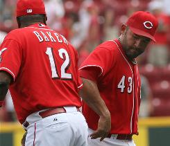 Reds manager Dusty Baker, left, congratulates Miguel Cairo after Cincinnati completed a three-game sweep of Florida.