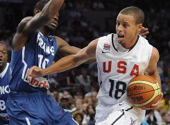 Team USA guard Stephen Curry drives against defensive pressure from France's Yannick Bokolo during the fourth quarter of their exhibition game.