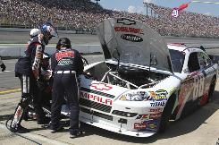 Dale Earnhardt Jr. comes in for an extended pit stop on his way to a 19th-place finish at Michigan International Speedway.