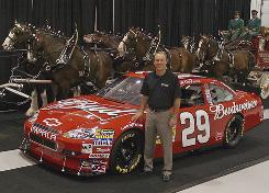 Kevin Harvick shows off his new No. 29 ride for next season at a news conference at the Richard Childress Racing shop.