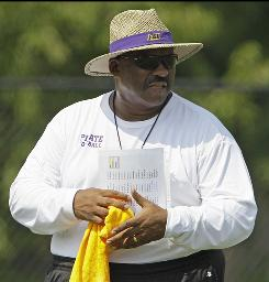 East Carolina University football coach Ruffin McNeill watches his team during practice in Greenville, N.C.